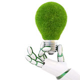 Lightbulb. Green light bulb in the hand of the robot. Isolated on white Royalty Free Stock Photography