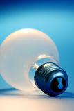 Lightbulb. On blue background stock photo