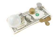 Lightbulb on american dollar background Royalty Free Stock Images