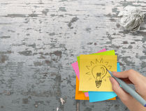 Lightbulb as creative on crumpled sticky note Royalty Free Stock Photos