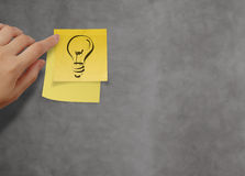 Lightbulb as creative on crumpled sticky note paper Royalty Free Stock Image
