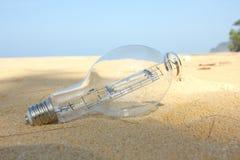 Lightbulb on beach Royalty Free Stock Photos