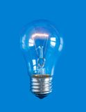 Lightbulb on blue background Royalty Free Stock Photography