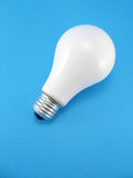 Lightbulb on blue background. Royalty Free Stock Images