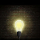 Lightbulb brick wall Royalty Free Stock Image
