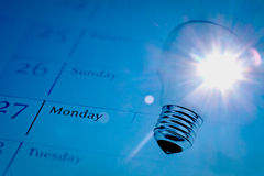 Lightbulb on calendar with sunlight Royalty Free Stock Images