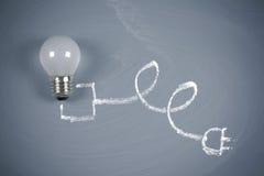 Lightbulb on chalkboard Royalty Free Stock Image