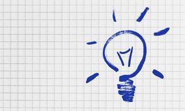 Lightbulb on checkered writing pad concept stock images