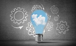Eco innovations concept by means of lightbulb. Royalty Free Stock Photo