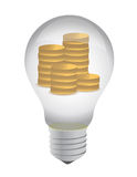 Lightbulb with coins inside Royalty Free Stock Photo