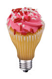 Lightbulb cupcake. Incandescent lightbulb with a cupcake inside isolated over white with a clipping path Stock Images