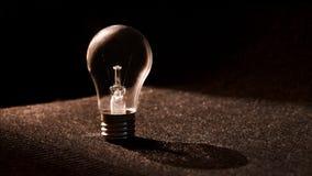 Lightbulb on dark background Stock Photography