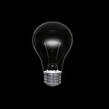 Lightbulb in dark Stock Photos