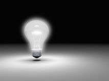 Lightbulb in dark Stock Photography
