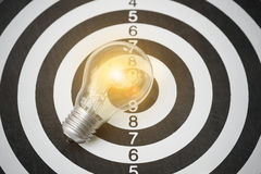 Lightbulb on dartboard. concept goal for new ideas. With innovation and creativity Stock Image