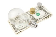 Lightbulb and Dollars with coins Stock Photos