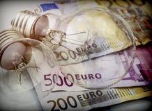 A lightbulb on euro bill, energy saving concept. Conceptual image Stock Photo