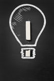 Lightbulb and exclamation point illustrating concept of idea Stock Photos