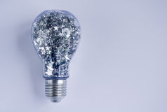 Lightbulb Filled With Shiny Silver Stars Royalty Free Stock Images