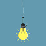 Lightbulb on fishhook Royalty Free Stock Images