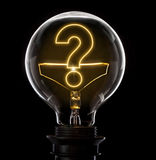 Lightbulb with a glowing wire in the shape of a question mark s Royalty Free Stock Photos