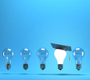 Lightbulb with graduation hat Stock Photography