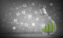 Progressing graph inside lightbulb. Lightbulb with green growing graph inside placed against sketched social network system on grey wall. 3D rendering Stock Photography