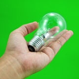 Lightbulb in hand Stock Photos