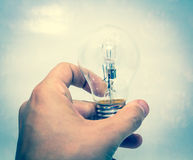 Lightbulb in hand Royalty Free Stock Images