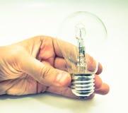 Lightbulb in hand Stock Photo