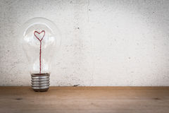 Lightbulb with Heart Shaped Filament Stock Images