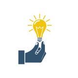 Lightbulb holding hand Royalty Free Stock Photo