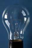 Lightbulb I. Closeup of a lightbulb, blue background royalty free stock image