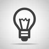 Lightbulb icon with shadow on a gray background. Vector illustration royalty free illustration