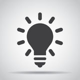 Lightbulb icon with shadow on a gray background. Vector illustration stock illustration