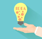 Lightbulb idea. Concept with hand at flat design and long shadow Royalty Free Stock Image