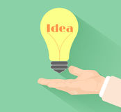 Lightbulb idea. Concept with hand at flat design and long shadow Stock Photography