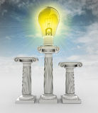 Lightbulb invention symbol on column with sky Royalty Free Stock Images