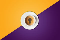 Lightbulb made in cup of coffee. Brain storm, idea concept or coffee-break. royalty free stock photo