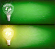 Lightbulb over green background Stock Photos