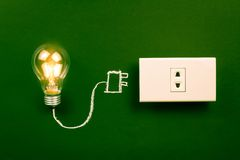 Lightbulb and plug Royalty Free Stock Photography