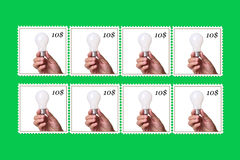 Lightbulb in a postage stamp Stock Images