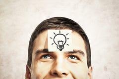 Lightbulb sketch on guy's forehead Stock Image