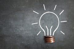 Money lightbulb Stock Photos