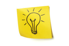 Lightbulb on sticky note. Lightbulb drawn on sticky note stock photo