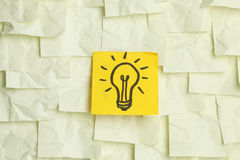 Lightbulb on sticky notes Royalty Free Stock Image