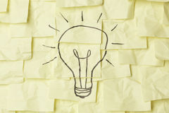 Lightbulb on sticky notes Stock Image