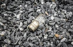 Lightbulb on stone Royalty Free Stock Photography