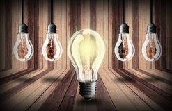 Lightbulb  on wood planks texture background Royalty Free Stock Photo