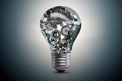 Lightbulb z powikłanym cogwheel mechanizmem - 3d rendering Zdjęcie Royalty Free